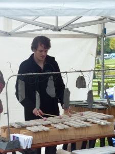 Tommy Leatherbarrow playing a stone xylophone